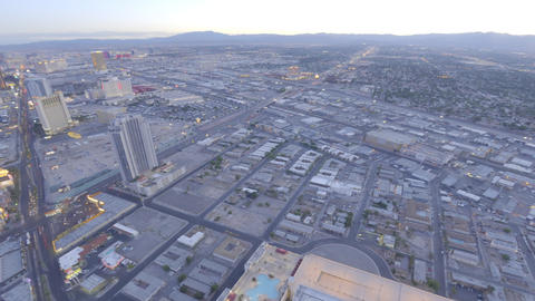 Zooming view of nightfall in Las Vegas from the Stratosphere Hotel Live Action