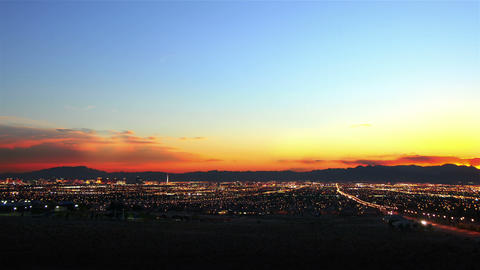A sped up panoramic view of all of las vegas and the mountains behind las vegas  Footage