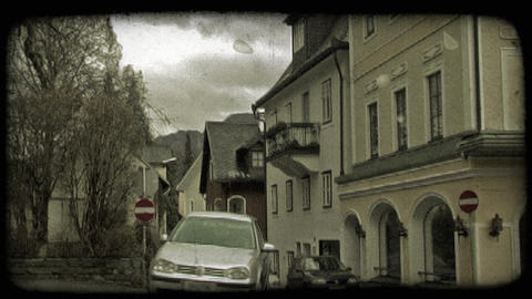 Car on European street. Vintage stylized video clip Footage