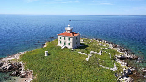 Aerial - Solitude lighthouse on a small island with crystal clear water Footage