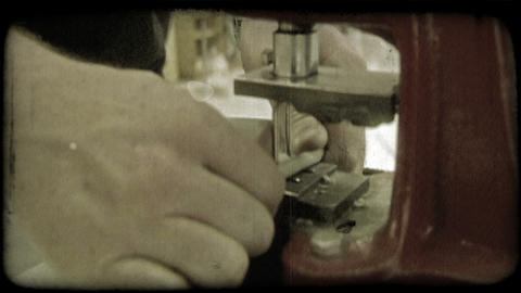 Insertion of metal rings. Vintage stylized video clip Footage