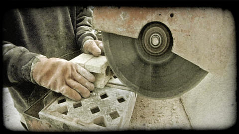 Worker cuts bricks. Vintage stylized video clip Footage