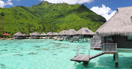 Travel vacation paradise video background with overwater bungalows in sea water Footage