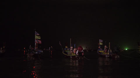 Fishing boats floating in the sea. Fishing in night time GIF