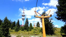 Empty chair lift ascending in Pamporovo winter mountain ski resort in Bulgaria Footage