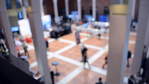 Blurred View of People. People in a large modern hall. Blurred Background Footage