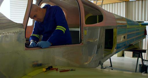 Engineer repairing aircraft in hangar 4k Live Action