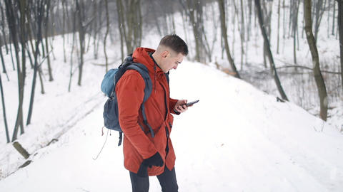 Man Using Mobile Compass in Forest Footage