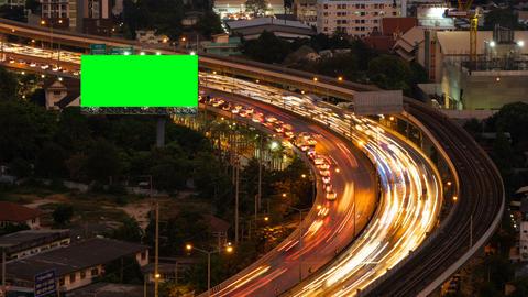 Green screen billboard with traffic jam on road at highway for advertising in Live Action