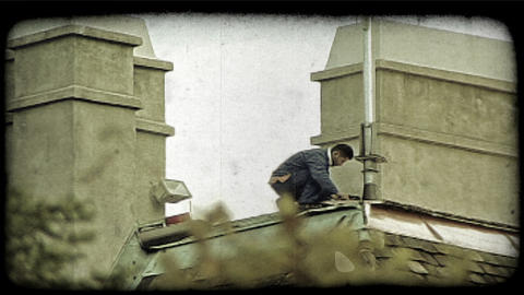 Roofer at work. Vintage stylized video clip Footage