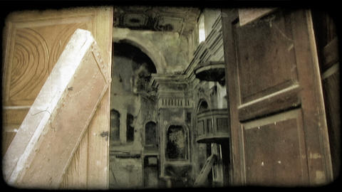 Footage of the doorway and interior of an abandoned building. Vintage stylized v Footage