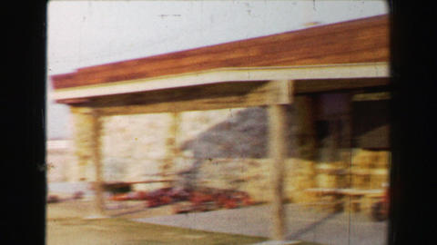 1968: Newly constructed golf clubhouse in barren southwestern USA desert driving Footage
