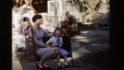1957: Horse powered amusement park chair ride kids enjoy the ride Footage
