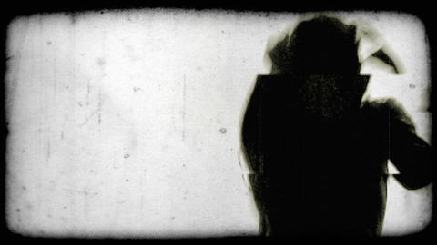 Silhouette of a dancing young woman. Vintage stylized video clip Footage