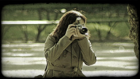 Woman takes picture. Vintage stylized video clip Footage