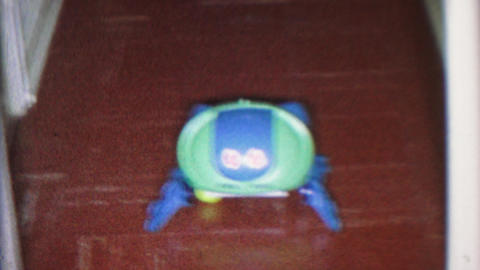 1965: Wacky robot toy chasin a ping pong ball sticking out tongue play Footage