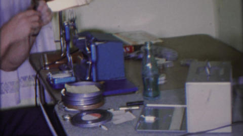 1965: Cinematographer Editing Table 8mm Super 8 Films Viewer Unwinding Reels stock footage