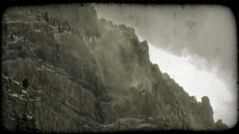 Snow drifts on cliffs. Vintage stylized video clip Footage