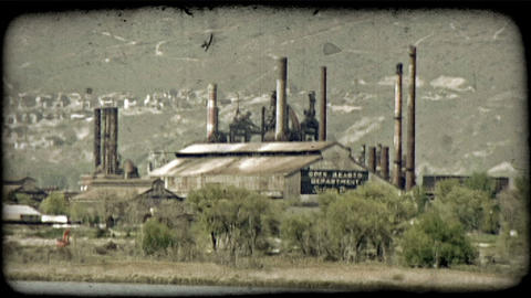 Energy plant near mountains. Vintage stylized video clip Footage