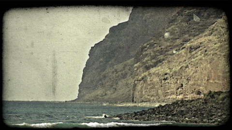 Blue green waves and cliffs. Vintage stylized video clip Footage