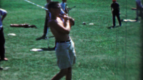 1969: Shirtless young boys practicing golf at driving range hitting balls swingi Footage