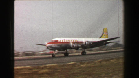1967: Transocean Airline Propeller Airplane Takeoff Runway Travel High Speed stock footage