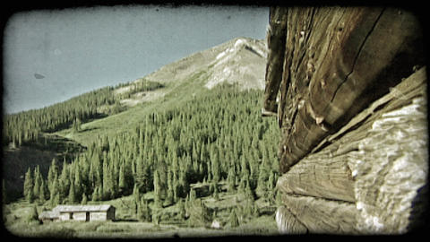 Old log cabin and mountain. Vintage stylized video clip Live Action