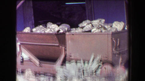 1968: Old mining tourist display town fake gold painted rocks mucking carts Footage