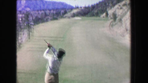 1968: Women golfer driving tee plays beautiful mountain golf course on summer da Footage