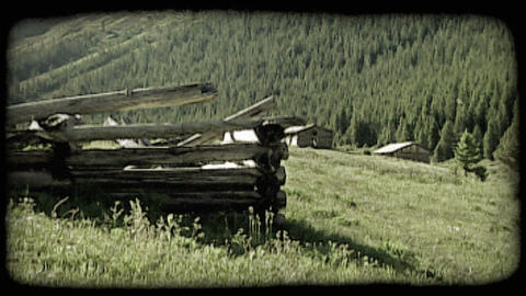 Old cabin remains in mountains. Vintage stylized video clip Live Action