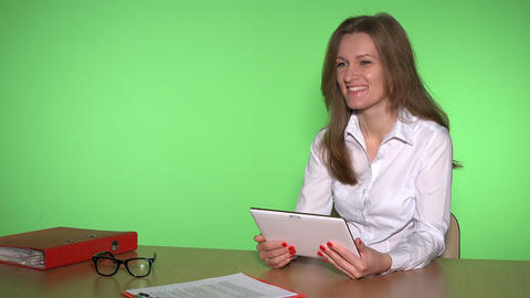 girl with tablet computer in business meeting concept. Woman in white ビデオ