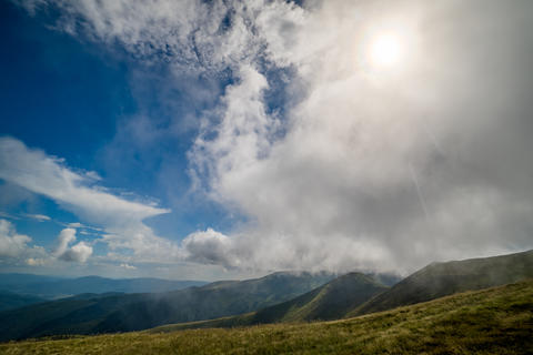 Landscape of Borzhava ridge of the Ukrainian Carpathian Mountains. Clouds above フォト