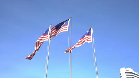 three Malaysian flags waving in Kuala Lumpur Footage