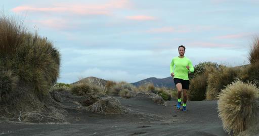 Running man trail runner in nature landscape enjoying training run Footage