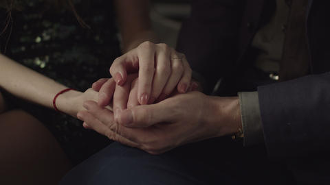 Passionate couple in love holding hands indoors Footage