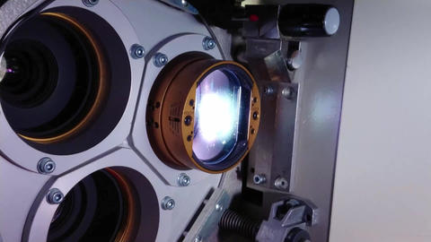 Vintage 35mm film running through a cinema projector in a movie theater Footage