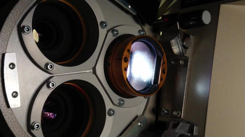 Close up of a 35mm cinema projector in a movie theater Stock Video Footage