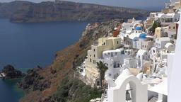 Greece Aegean Sea Cyclades Santorini white houses of Oia at hillside GIF