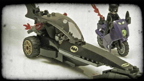 Lego Batman pulls up alongside Lego catwoman. Vintage stylized video clip Footage