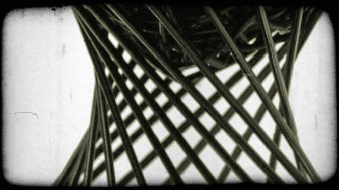 Design made of thin black rods, appears to be rotating. Vintage stylized video c Footage