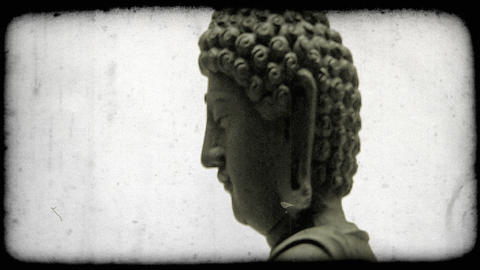 Tilting shot of a buddha. Vintage stylized video clip Live Action