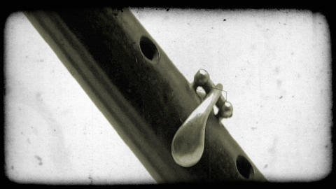 Close-up tilting shot of a katana sword. Vintage stylized video clip Footage