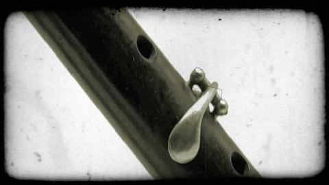 Close-up tilting shot of a katana sword. Vintage stylized video clip Live Action
