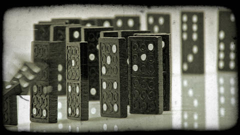 Close-up shot of falling dominoes. Vintage stylized video clip Footage