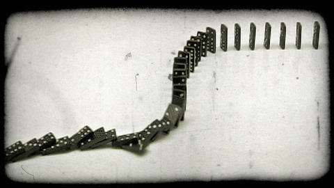 Shot of dominoes toppling on top of each other. Vintage stylized video clip Footage
