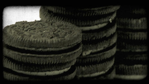 Tilting shot of oreo sandwich cookies. Vintage stylized video clip Live Action