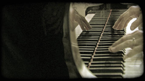 Static shot of hands playing the piano. Vintage stylized video clip Footage