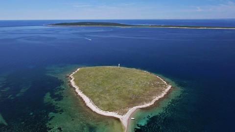 Aerial - Two small Croatian islands with white beach and nice blue water around Footage