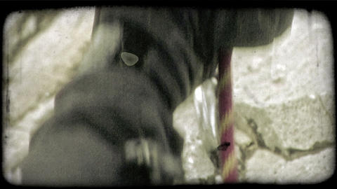 Mountain climber hooks rope to carabiner. Vintage stylized video clip Footage