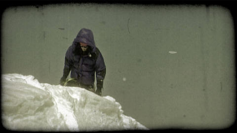 Climber walks along snowy bank. Vintage stylized video clip Footage